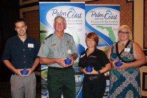 The award winners. From left, Jason Hutsel of the Flagler Fish Company, Anthony Greaves, a Florida park ranger at Gamble Rogers State Park, Sky Austin of Marineland Dolphin Adventure, and  Kellie Scribner of Best Western Click on the image for larger view. (Tourist Development Council)