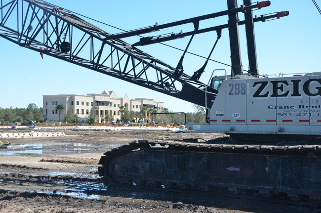 Palm Coast's future city hall, under construction in Town Center, helped attract new commercial tenants to the long-dormant first floor of the Cite building nearby. (c FlaglerLive)