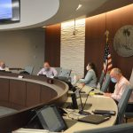 Local officials at noon today preparing for the last weekly Palm Coast town hall on Covid-19, which Mayor Milissa Holland had been anchoring since near the start of the pandemic locally. From left, Palm Coast Fire Chief Jerry Forte, City Manager Matt Morton, Holland and Health Department Director Bob Snyder. (© FlaglerLive)