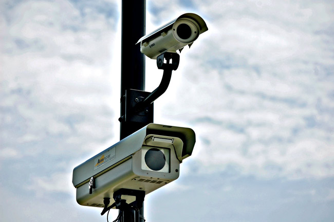American Traffic Solutions spy-and-snap traffic cameras, at an intersection near you. (© FlaglerLive)