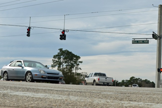 Traffic may improve at intersections in Palm Coast, but synchronizing lights will still not be part of the system. (© FlaglerLive)