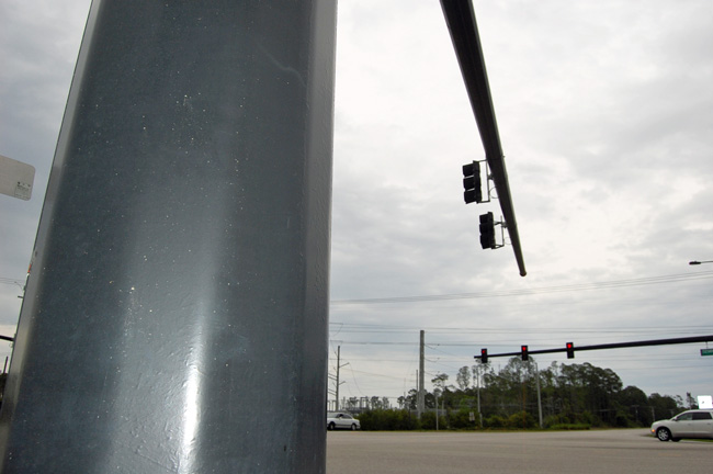 Traffic signals hanging from wires are being replaced by rod-like hardware across Palm Coast as part of a modernization of the city's 50 signals. (© FlaglerLive)