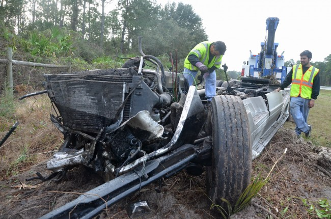 The remains of the trailer, as Roger's Towing's crew worked on it. Click on the image for larger view. (© FlaglerLive)