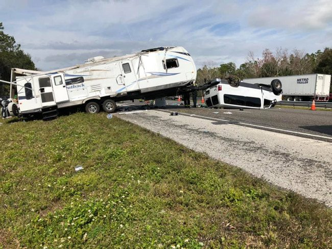 The van towing a large RV flipped, and I-95 southbound was closed at Matanzas Woods Parkway as a result. (Flagler County Professional Firefighters)