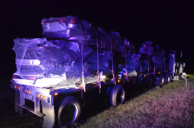 The trailer was carrying scrap cars from Fort Pierce to Savannah. Click on the image for larger view. (© FlaglerLive)