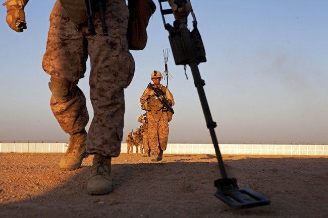 U.S. Marine Corps Lance Cpl. Ryan Burdge, front, uses a metal detector during counter improvised explosive device training on Camp Leatherneck in Helmand province in 2013. Click on the image for larger view. (Sgt. Tammy K. Hineline)