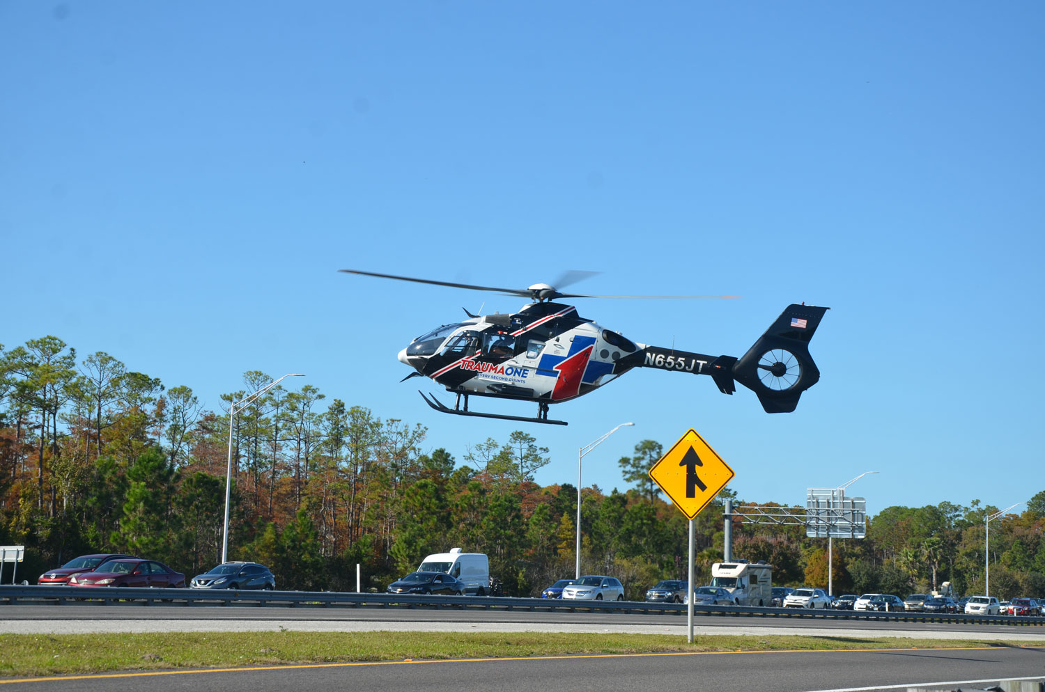 Trauma One, thje emergency helicopter, lifting off from the northbound lanes of I-95 near the juncture with State Road 100, with one patient, at 2 p.m. this afternoon. (c FlaglerLive)