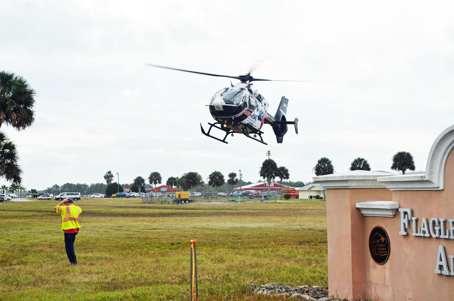 Trauma One lifting off with a patient from a field in front of the county airport. (© FlaglerLive)