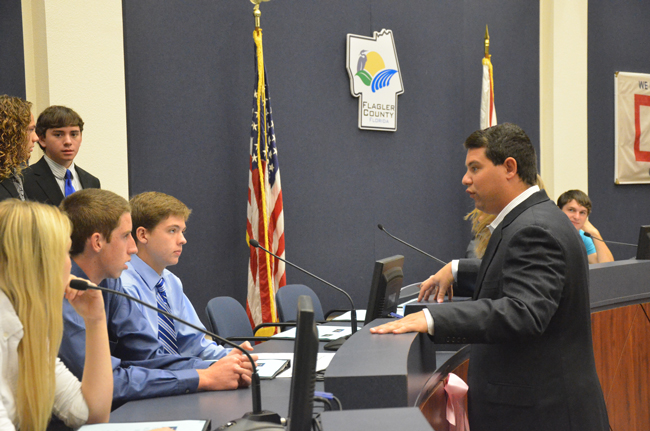 Rep. Travis Hutson conferring with students from Flagler Palm Coast High School and Matanzas High School in October, during an elimination process that led to the animal cruelty bill Hutson filed on Jan. 17. (© FlaglerLive)