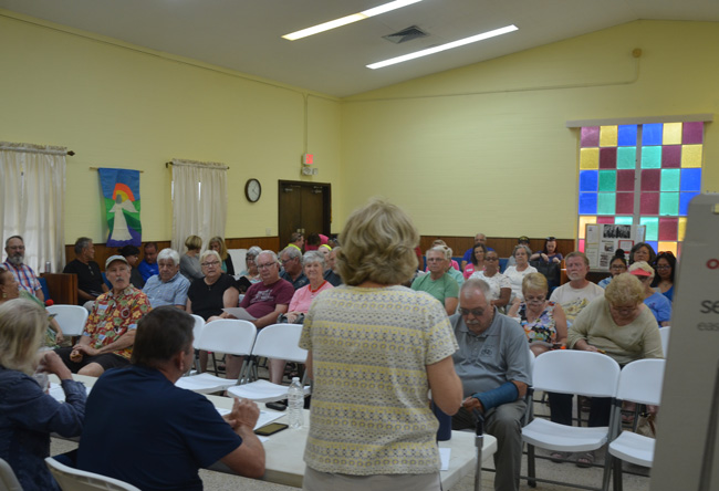 Sue Bickings, right, addresses some 70 people at a meeting of the Sheltering Tree board in Bunnell this afternoon. The meeting was to discuss ideas on countering Bunnell's decision to shut down the cold-weather shelter after 11 years. (c FlaglerLive)