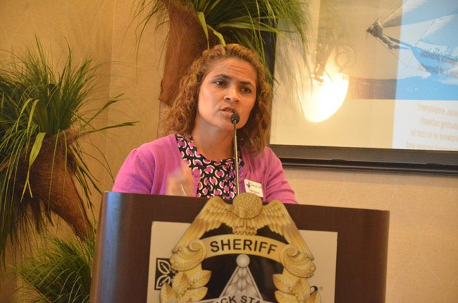 Trish Giaccone, executive director of the Family Life Center, Flagler's shelter for abused women and children, speaking at the kick-off of the domestic violence task force in June. (© FlaglerLive)