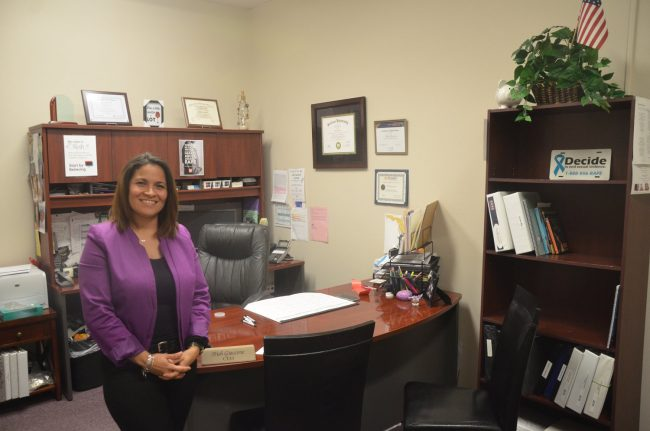 Family Life Center Executive Director Trish Giaccone in her new office. (© FlaglerLive)