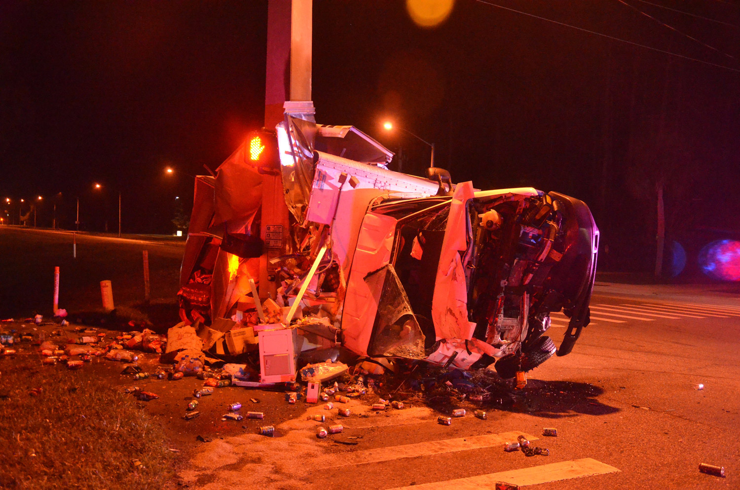 The Canteen junk-food delivery truck was criushed against a concrete light pole at Palm Coast Parkway and Belle Terre Parkway before dawn this morning. Click on the image for larger view. (© FlaglerLive)