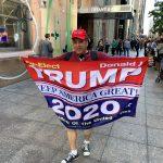 A Trump fan near Trump Tower in Manhattan in June 2019. (© FlaglerLive)