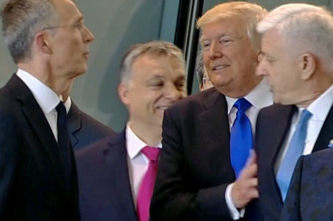 The ugly American in Europe: President Trump shoves his way past Dusko Markovic, the leader of Montenegro, at the NATO summit this week.