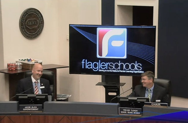 Flagler County School Board Chairman Trevor Tucker, right, with Superintendent Jacob Oliva, who heard several tributes this evening as he preparees to give way to Superintendent James Tager, whose contract was approved this evening. (© FlaglerLive)