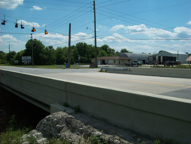 The intersection of County Road 304 and County Road 305, known as Tucker's Turnpike--for Tucker Insurance, in the background at the corner--where Bobby MacDonald brought his wife Kathy with a gunshot wound to the head on July 20, 2012. (Tucker Insurance)