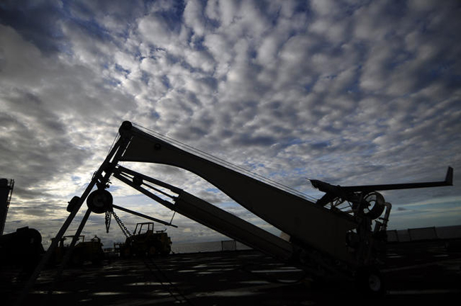 A ScanEagle drone, or unmanned aerial vehicle aircraft (UAV), preparing to launch from the deck of a ship in the Paciffc. (Joseph M. Buliavac)