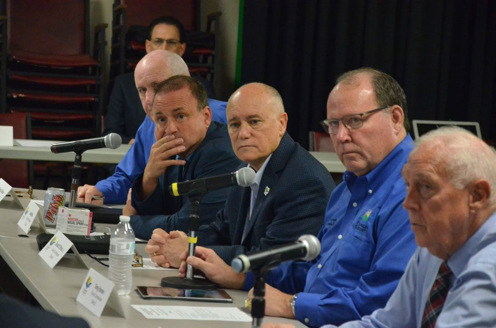 Flagler County commissioners today unanimously endorsed a proposed UNF partnership with Palm Coast to create a medical hub in Town center as the county's top legislative priority for 2020. From left, Commissioners Dave Sullivan, Joe Mullins, Donald O'Brien (who chairs the commission), Greg Hansen and Charlie Ericksen. (© FlaglerLive)