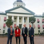 Palm Coast Mayor Milissa Holland today in Tallahassee, where she's been lobbying state lawmakers to land the University of North Florida's MedNex hub in Town Center, with, from left, City Manager Matt Morton, Allette Energy Chief Financial Officer and Douglas Properties President Jeff Douglas. (Palm Coast)