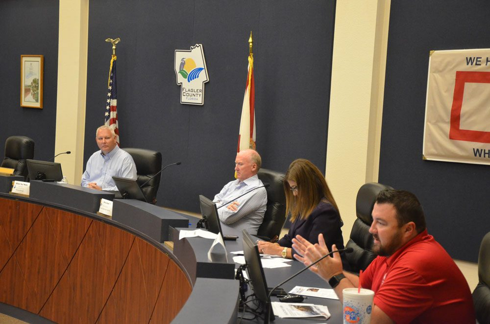 The U.S. Corps of Engineers briefed the public about its dunes-reconstruction project set to begin next spring in Flagler Beach, at a public hearing in Bunnell earlier this week. From left, Planning Manager William Weeks, consultant Chris Creed, County Engineer Faith al-Khatib, and Project Manager Jason Harrah. (© FlaglerLive)
