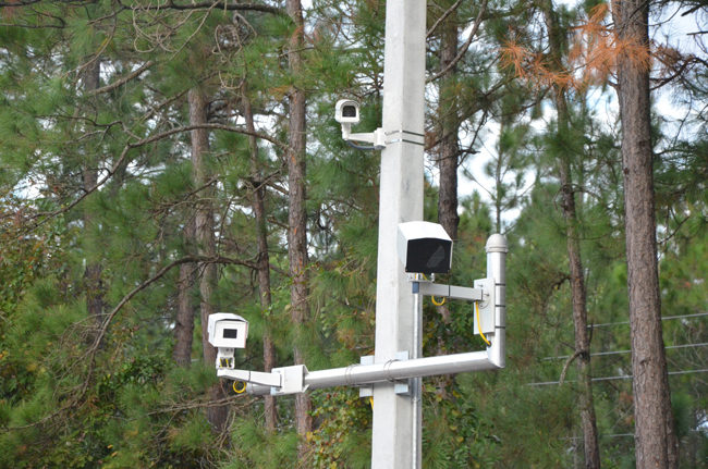 Crews last week installed video cameras on both sides of U.S. 1 between Royal Palms Parkway and Whiteview Parkway to monitor the weight of large trucks. (© FlaglerLive)