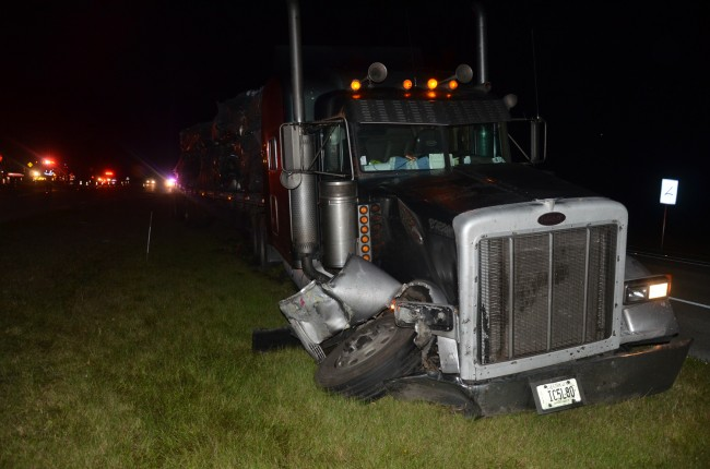 The 18-wheeler was severely damaged as it took evasive action to avoid hitting the F-150 head-on. The tractor trailer ended up in the median. Click on the image for larger view. (© FlaglerLive)