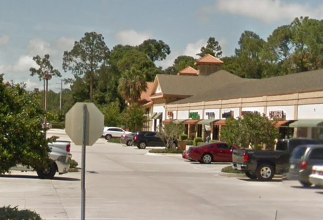 The strip mall on Palm Coast's Utility Drive where Vacation Pros' office was ransacked.