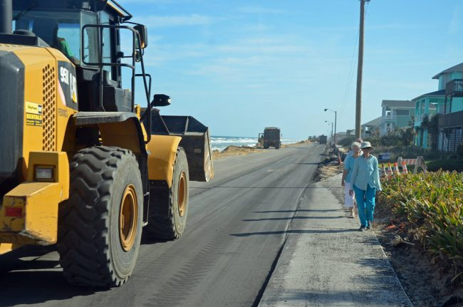 Valerie Reither took a walk with friends along the newly paved, emergency section of A1A in Flagler Beach, set to re-open next week. The road leaves no room between pavement and sidewalk. Click on the image for larger view. (© FlaglerLive)