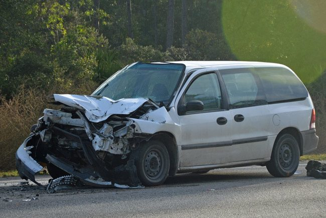 The Ford Windstar rear-ended a dump truck early this morning on U.S. 1 in Palm Coast. (© FlaglerLive)