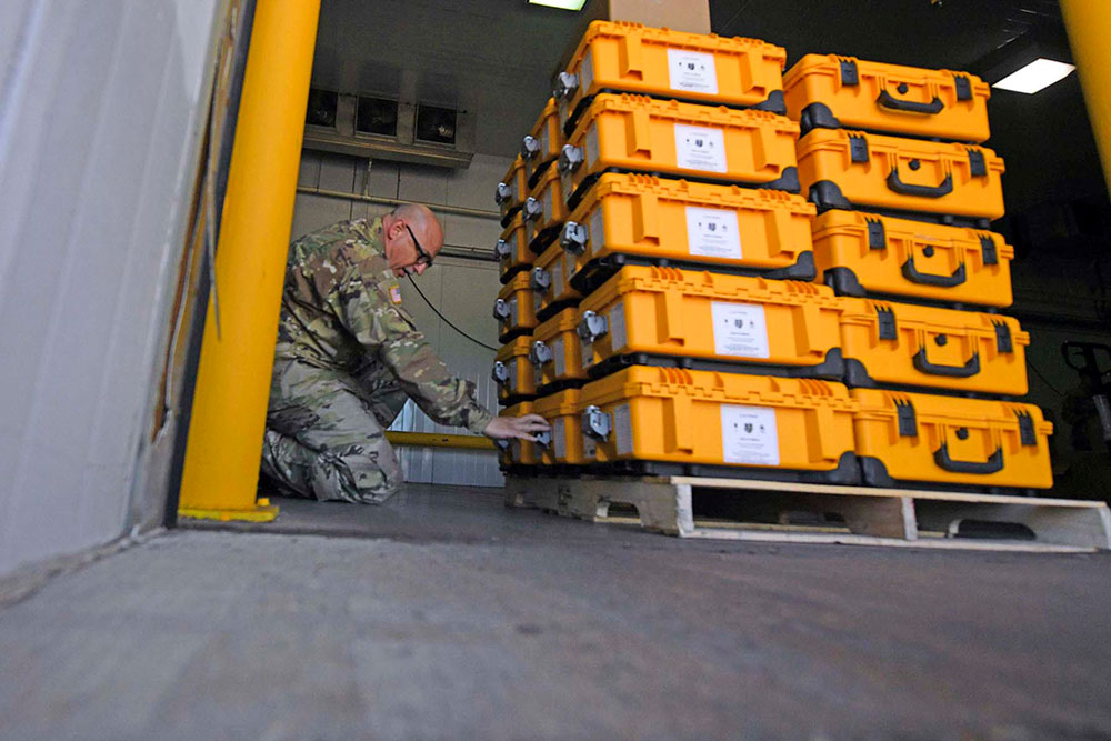 Army Master Sgt. Brooks Young, a Louisiana National Guardsman, helps package and ship ventilator equipment to support the state and federal COVID-19 response in Baton Rouge, La., April 1, 2020.