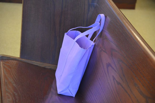 The victim's advocate purple bag, often seen during court proceedings at the Flagler County Courthouse. It contains items of comfort for victims who may be in court, attending proceedings related to their case. They are always accompanied by the advocate. (© FlaglerLive)