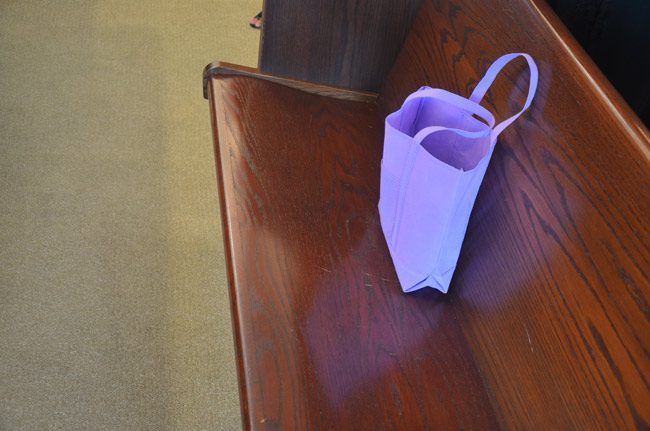 The purple bag that often accompanies the victim's advocate in Flagler County court. The bag contains tissue paper and comfort items for victims who sit through their assailant's trials or hearings. (© FlaglerLive)
