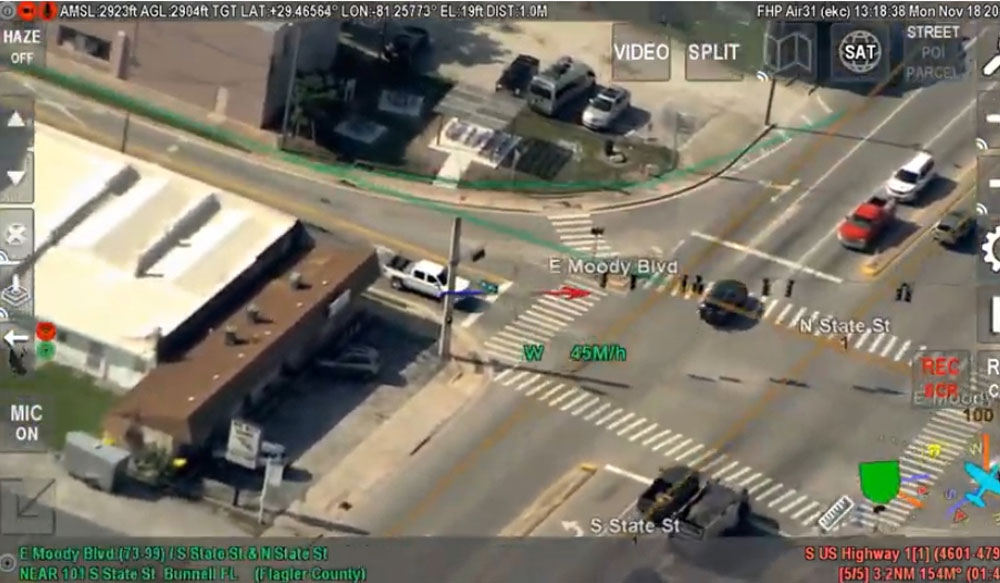 The suspects' black behicle as it weaved from the northbound lanes to the southbound lanes, seen from a Florida Highway Patrol aircraft that was tracking it.