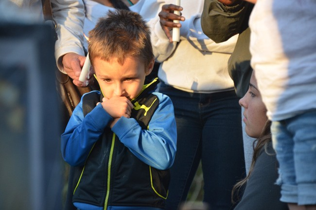 Elisa Marie Homen's son Vincent Vento Jr., who'll be 4 on February 1, was among the 50 people who turned up for a memorial Tuesday evening for Homen, at the site of the crash where she was fatally injured on Jan. 9. (© FlaglerLive)