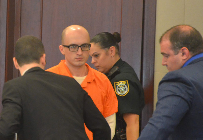 Vitaly Tsabak arriving in court this afternoon. His attorney, Aaron Delgado, is to the right. (© FlaglerLive)