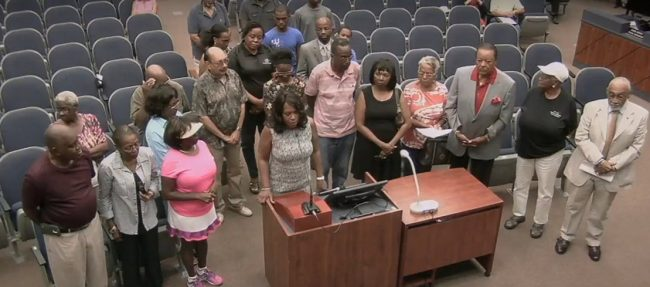 The voices unheard: the NAACP's Linda Sharpe-Matthews acknowledges today's proclamation, which sought to recognize the county's injustice toward minorities over the years. Click on the image for larger view. (© FlaglerLive/Flagler County TV)