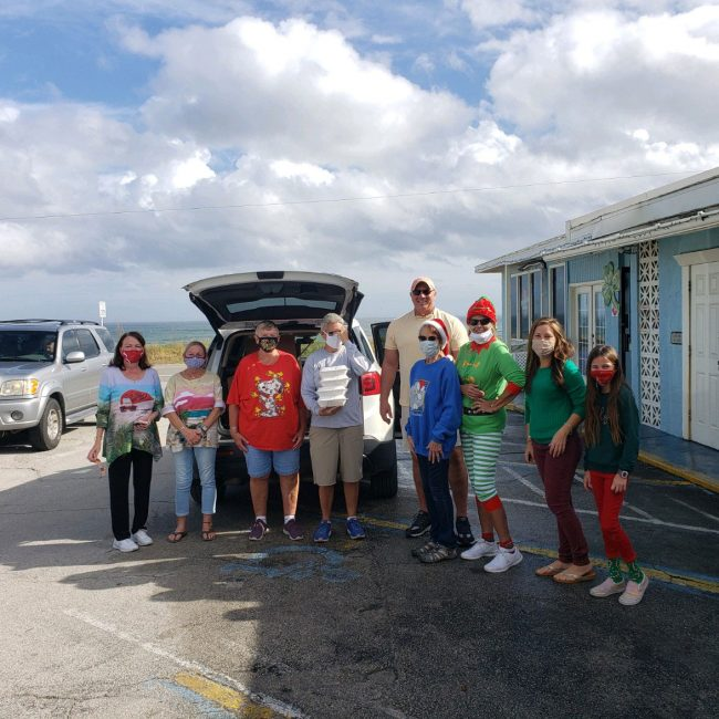 The team of volunteers today who delivered some 150 Christmas meals in Flagler Beach, compliments of Beachfront Grille. The distribution was organized by Flagler Beach Mayor Linda Provencher and Suzie Johnston. (Linda Provencher)