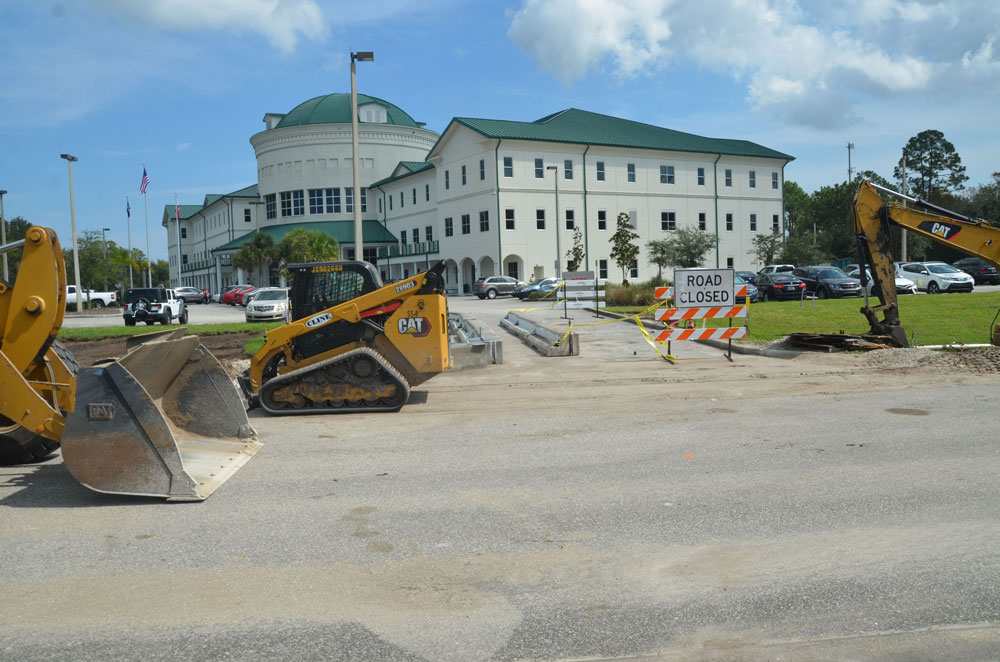 """The scene in front of the Government Services Building in Bunnell, where the Supervisor of Elections office is located, along with one of three early voting sites. County Administrator Jerry Cameron, who ordered the construction, says """"voting this year should be more convenient than ever."""" (© FlaglerLive)"""