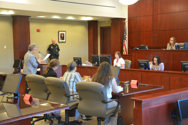 Clerk of Court Gail Wadsworth makes her case before County Judge Melissa Moore-Stens this morning. (© FlaglerLive)