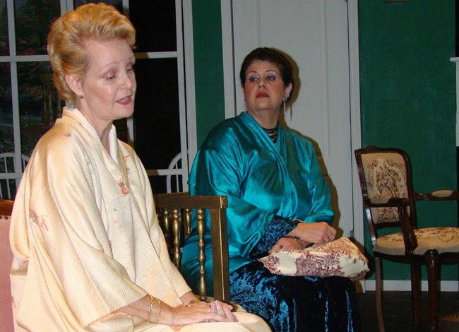 Contempt and contre-temps: the icy May Davenport (Anji Brazell) looks down on her old rival Lotta Bainbridge (Kathy Thompson) before their reconciliation in 'Waiting in the Wings.' (Flagler Playhouse)