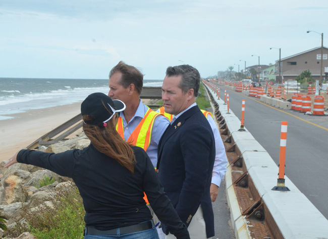U.S. Rep. Mike Waltz, whose district includes all of Flagler, getting a primer from County Engineer Faith al-Khatib today on the county's reconstruction efforts along the coast, with the state transportation department, following the 2016 and 2017 hurricanes. (© FlaglerLive)