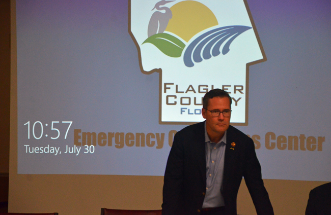 First-year Congressman John Waltz, whose district includes all of Flagler, getting set for his discussion with county directors this morning at the county's Emergency Operations Center. (c FlaglerLive)