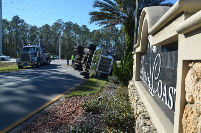 Welcome to Palm Coast: the semi overturned at the intersection of U.S. 1 with Palm Coast Parkway. (c FlaglerLive)