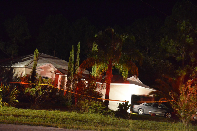 By midnight Thursday, crime tape had surrounded the house at 33 Westminster Drive in Palm Coast, where up to seven people were injured from an explosion and a resulting small fire. (© FlaglerLive)