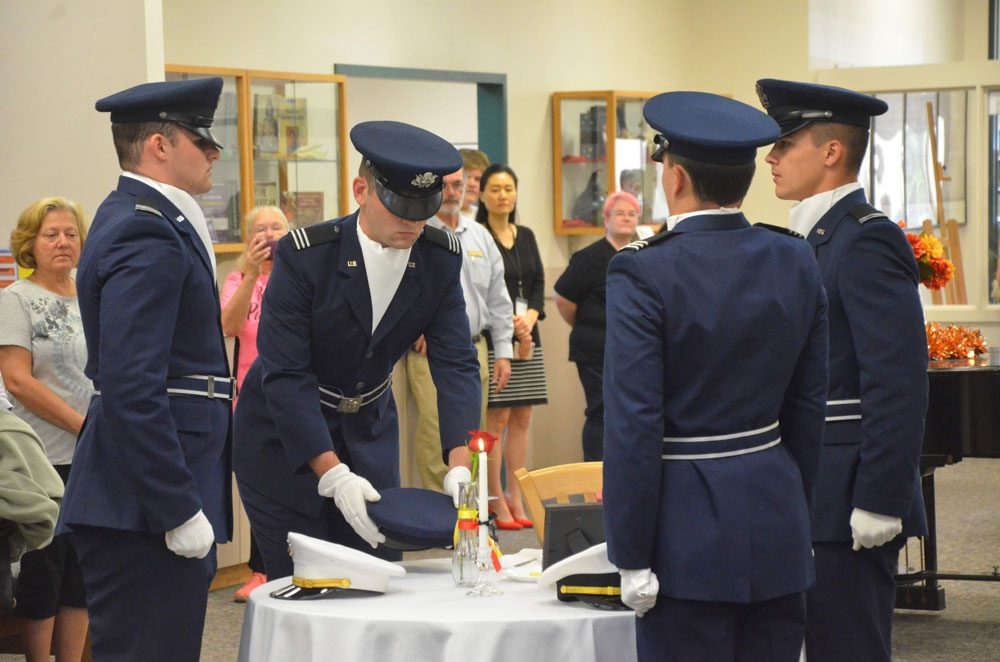 The Flagler County Public Library on Saturday (Nov. 9) hosted a White Table ceremony in remembrance of service members lost in wars. The ceremony was led by an ROTC detachment from Embry-Riddle Aeronautical University. (© FlaglerLive)