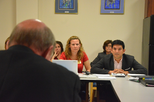 Will Vargas, right, of the Florida Educators Association, the teachers union, and Katie Hansen, president of the Flagler County Educators Association, during a bargaining session as they faced Jerry Copeland, the district's lead negotiator, last year. (© FlaglerLive)