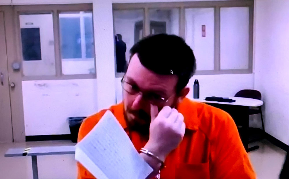 Brian Scott Wirth reading his statement for 20 minutes today from a jail room, before he was sentenced to life in prison. (© FlaglerLive)