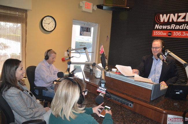 The Palm Coast administration's 'alternative' proposal would still have council members appearing on a local radio show, as was the case with Mayor Milissa Holland, above, with Rep. Paul Renner, on David Ayres's Free For All Friday on Feb. 24, but would drop the infomercial approach of a weekly show and focus instead on a free podcast. (© FlaglerLive)