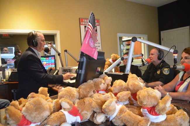 Tim and Lisa Hogan of State Farm donated some 100 teddy bears to the Flagler County Sheriff's Office  so deputies can carry them in their patrol vehicles and hand them out to children involved in domestic violence situations. Sheriff Rick Staly talked about the issue, with the Hogans present, on Free For All Friday last week, with host David Ayres, who arranged for the donation. (© FlaglerLive)